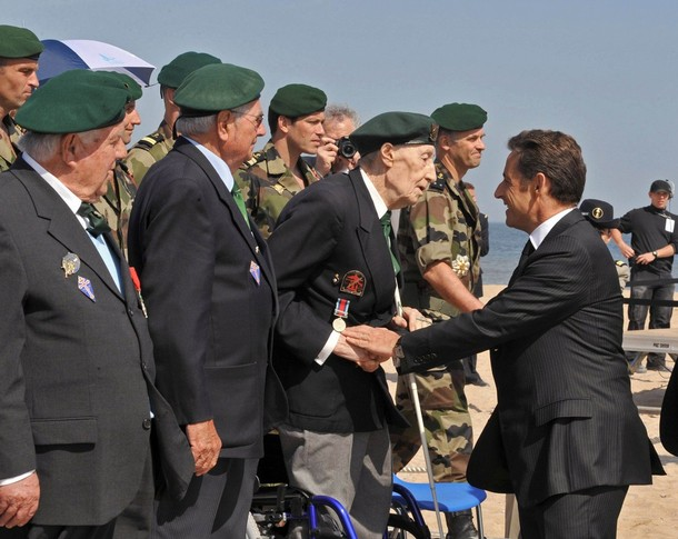 France's President Sarkozy shakes hands with Maurice Chauvet, member of the Kieffer commando, during Armistice Day ceremonies in Ouistreham